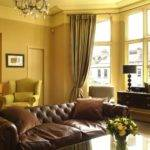 Brown Couch Yellow Walls Trendy Living Room