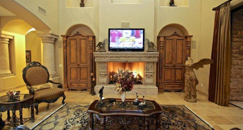 Mediterranean Living Room Stone Fireplace Carpet