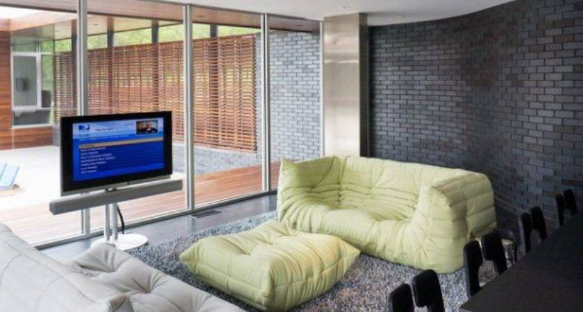 Rooms Featuring Comfortable Stylish Togo Sofas