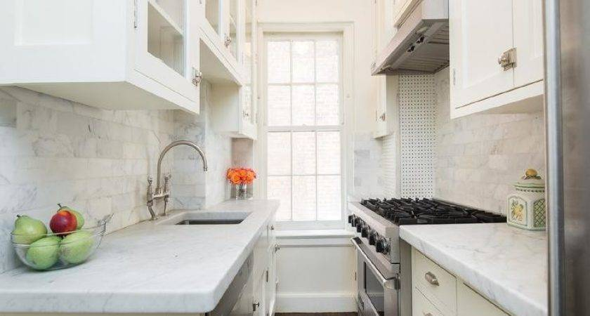 Small White Galley Kitchen Sink Across Stove